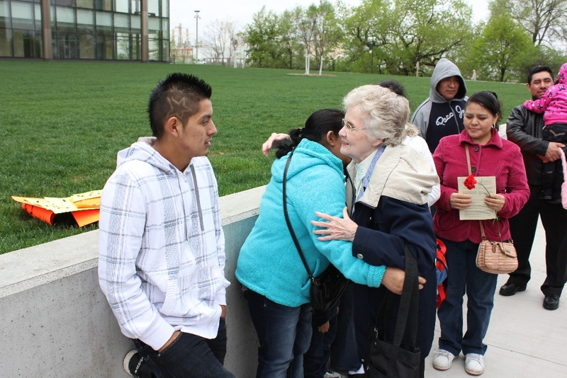 Sister Mary McCauley greets people.JPG